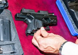 glock 43 in a man's hand glock 26 vs 43