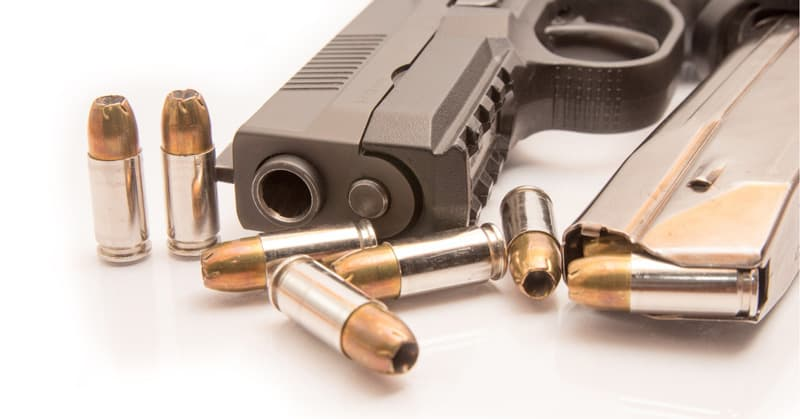 close-up photo of 9mm ammo, magazine and pistol