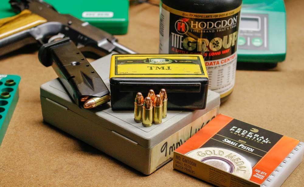 photo of 9mm ammo, magazine and boxes