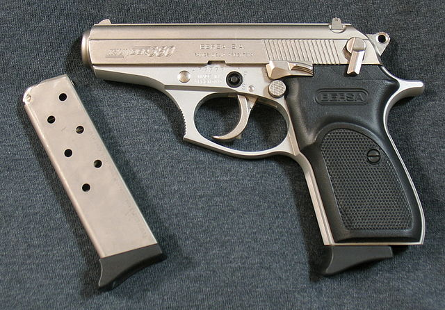 nickel 380 pistol and an extra magazine
