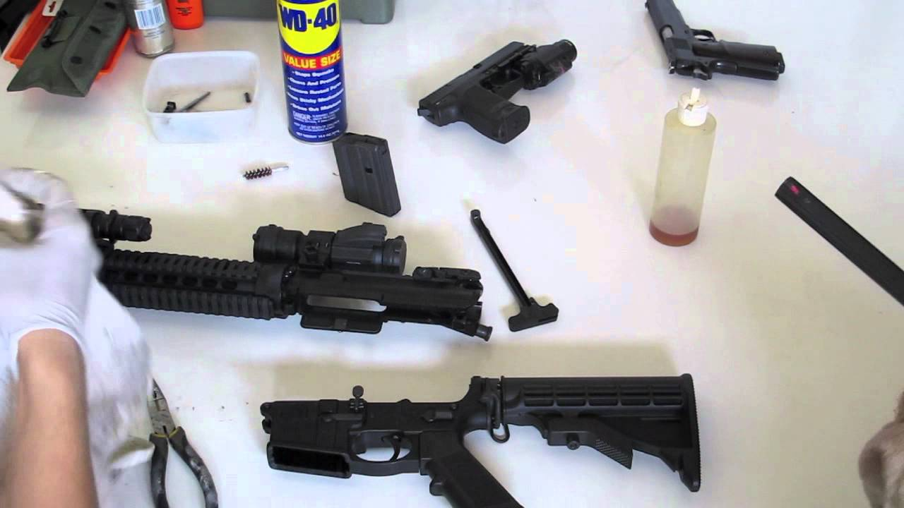 a dismantled long firearm being cleaned with WD-40 Solution to remove rust