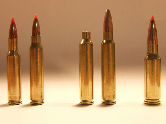 the 6.5 Creedmoor is on the right end with other three more bullets and one cartridge case
