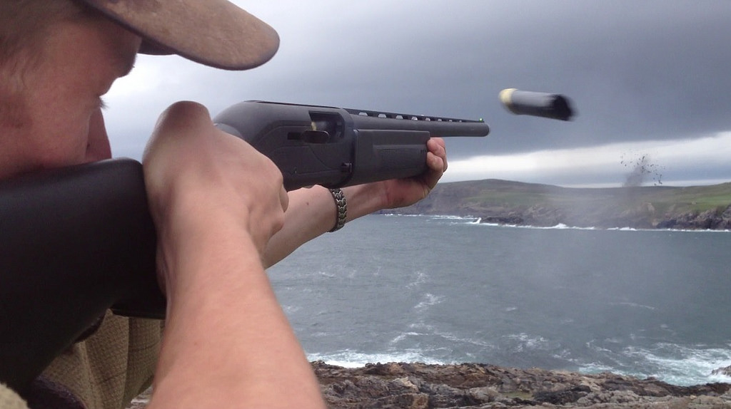 a man firing a semi auto shotgun