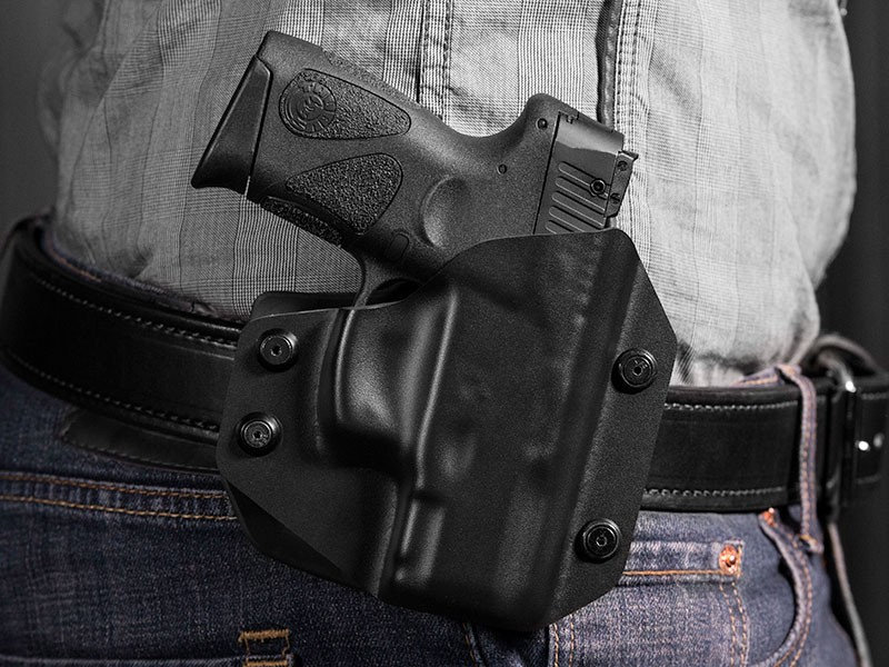 compact handgun and the worn handgun holster