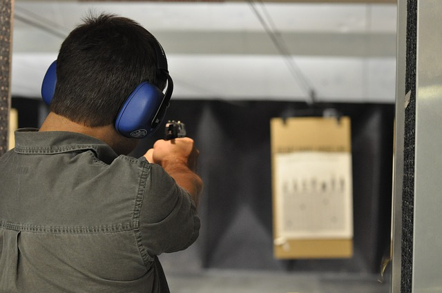 a man aiming the best compact 9mm handgun to the target